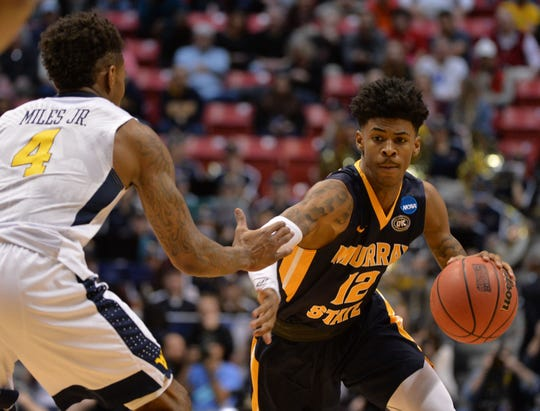 Murray State Racers guard Ja Morant (12) moves the ball against West Virginia Mountaineers guard Daxter Miles Jr. (4) during the second half in the first round of the 2018 NCAA Tournament at Viejas Arena.