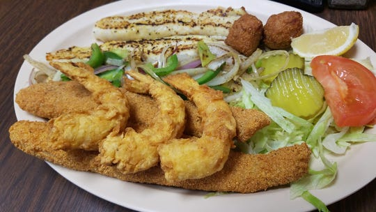 Sam's fried fish and shrimp are the star of the show, with a light cornmeal coating and hush puppies.
