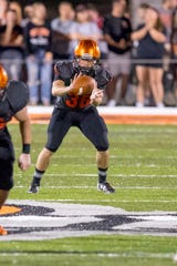 Clyde graduate Austin Baker takes a punt snap for Heidelberg against Olivet.