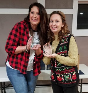 Andrea Gibson, left, was honored at the annual Chamber of Commerce of Sandusky County awards dinner on Thursday night with the Clark Ambassador Award. In this earlier photo she and Megan Craun were being honored for their work with the Sandusky County Young Professionals Group.