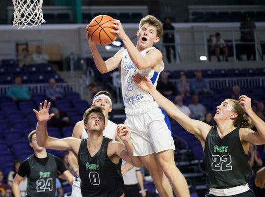 Canterburys' Bryson Royal comes down with the ball against Fort Myers High School on Monday during the City of Palms Classic tip-off game. Fort Myers won 72-60.