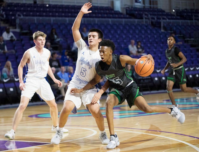 Fort MyersÕ Javian McCollum drives to the basket agains CanterburyÕs Alan Cedeno on Monday during the City of Palms Classic tip-off game. Fort Myers won 72-60.  McCollum led all scorers with 25 points.