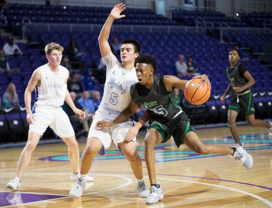 Fort Myers' Javian McCollum drives to the basket agains Canterbury's Alan Cedeno on Monday during the City of Palms Classic tip-off game. Fort Myers won 72-60. McCollum led all scorers with 25 points.
