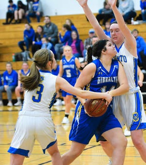 Oconto's Aubree Bucheger and Mara Allen apply tough defense and tie up the ball against Karlee Kita of Gibraltar on Dec. 13 in Oconto.