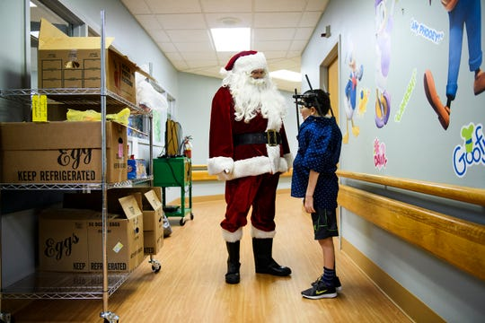 Grayson Lusk, 11, speaks with Santa Claus at Shriners Hospitals for Children Greenville on Monday, Dec. 17, 2018.