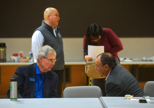 State Sen. Brian Hoven, R-Great Falls, left, and State Rep. Brad Hamlett, D-Cascade, talk during a listening session at Great Falls College MSU, Monday, to help form the local agenda ahead of the 2019 Legislative Session.