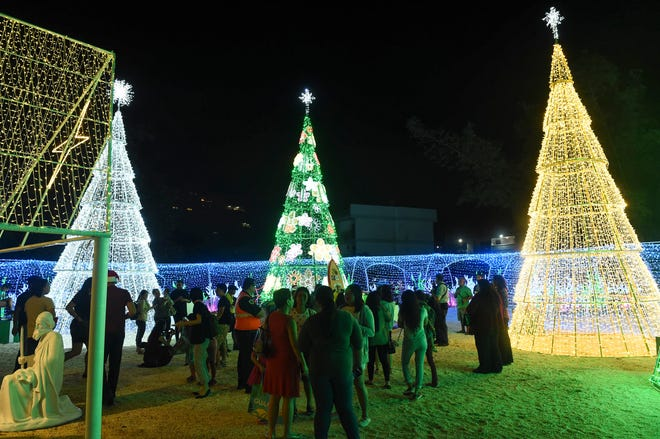 Crowds gather to see the light displays at the Guam Visitors Bureau's Christmas Village in Tumon, Dec. 17, 2018.
