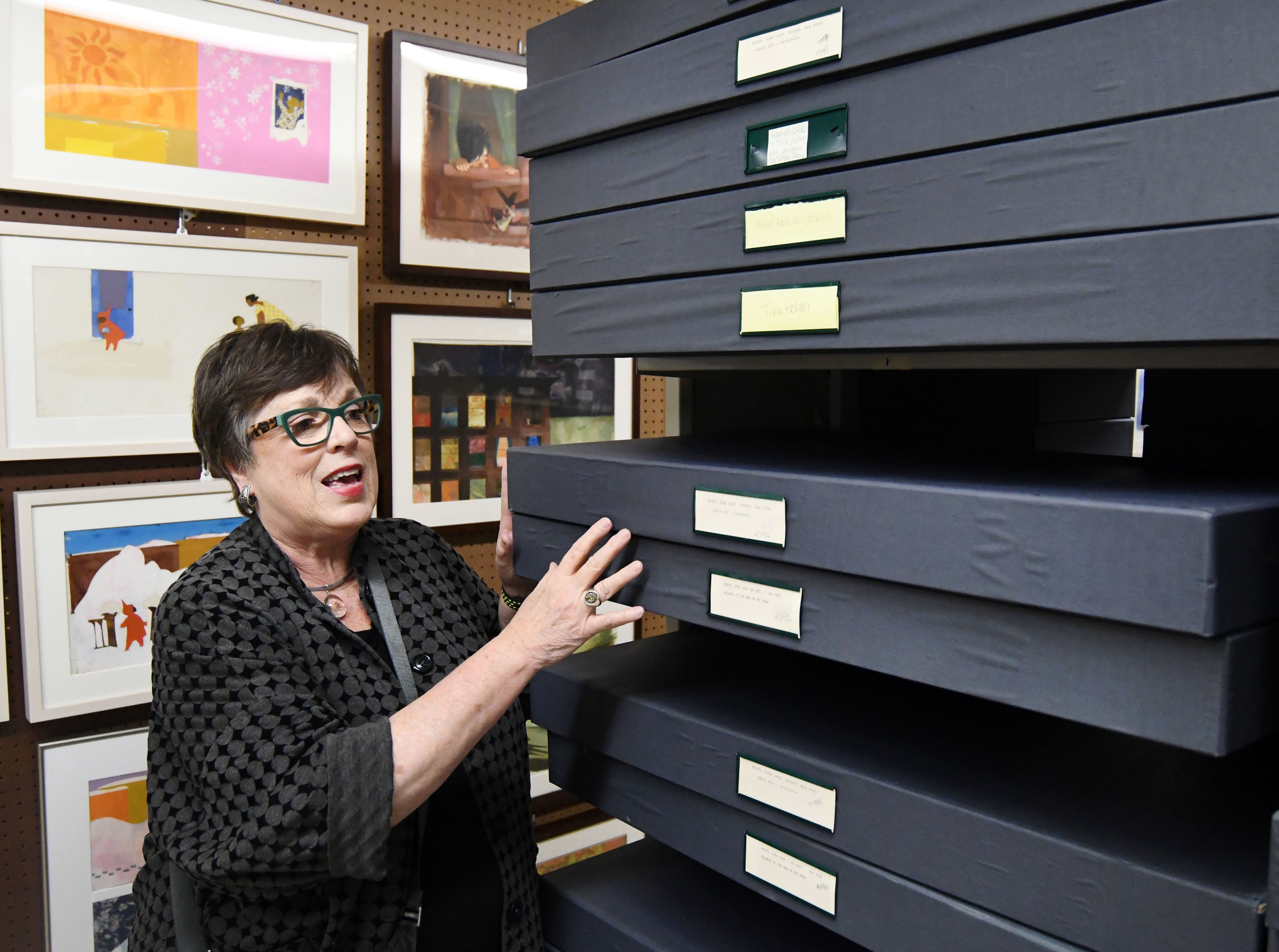 Curator of The de Grummond Children's Literature Collection at the University of Southern Mississippi Ellen Ruffin shows a collection of original artwork located in their archives at McCain Library. The collection is one of North America's leading research centers in the field of children's literature.