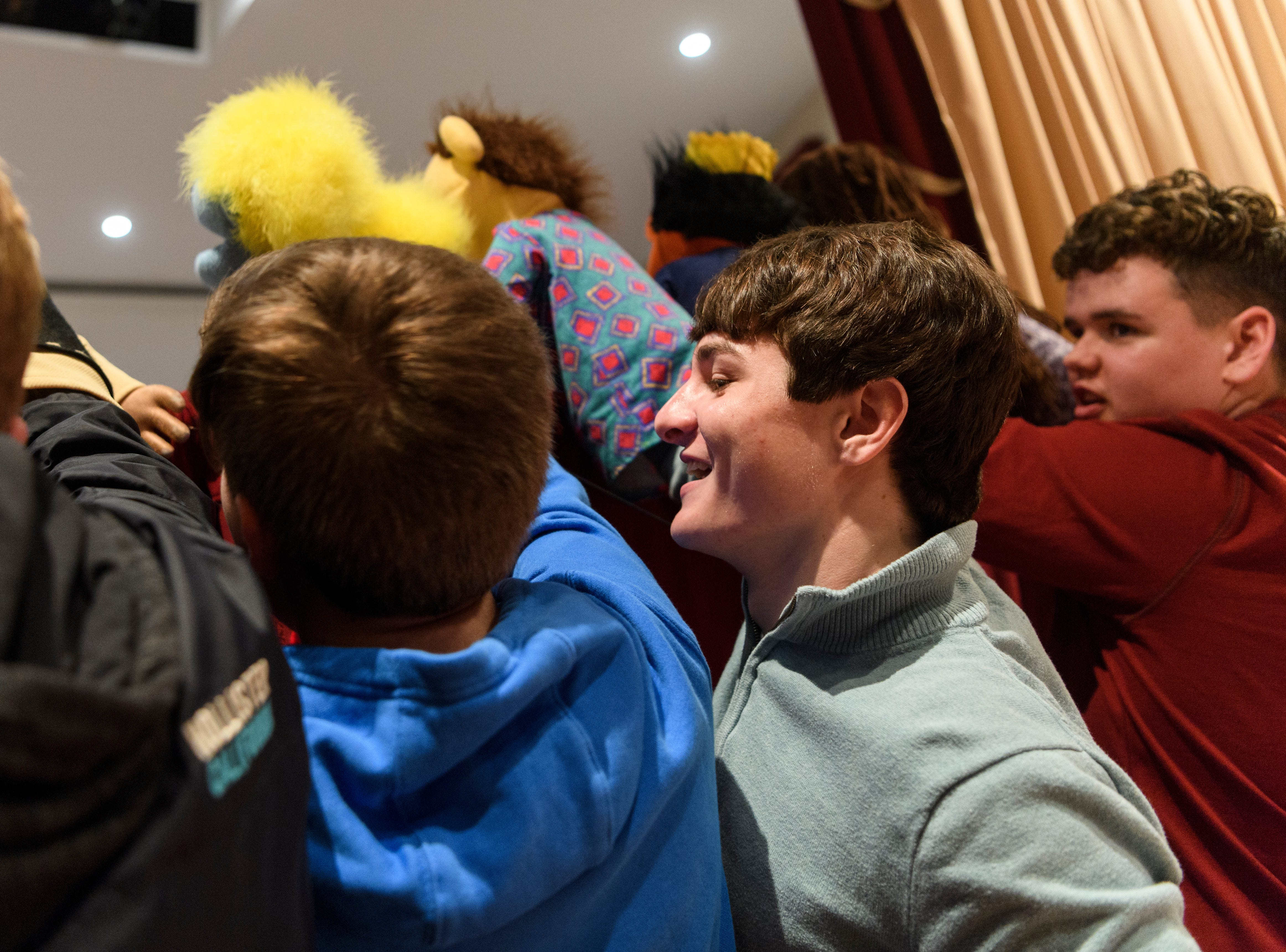 Ben Dalton, center right, jokes around with Jake Perry, center left, as they put on a puppet show for children during the Goodfellows Christmas party at South Middle School in Henderson, Ky., Sunday, Dec. 16, 2018. The puppet show was put on by First Baptist Church's tenth grade Sunday school class, which Dalton and Perry are members of.