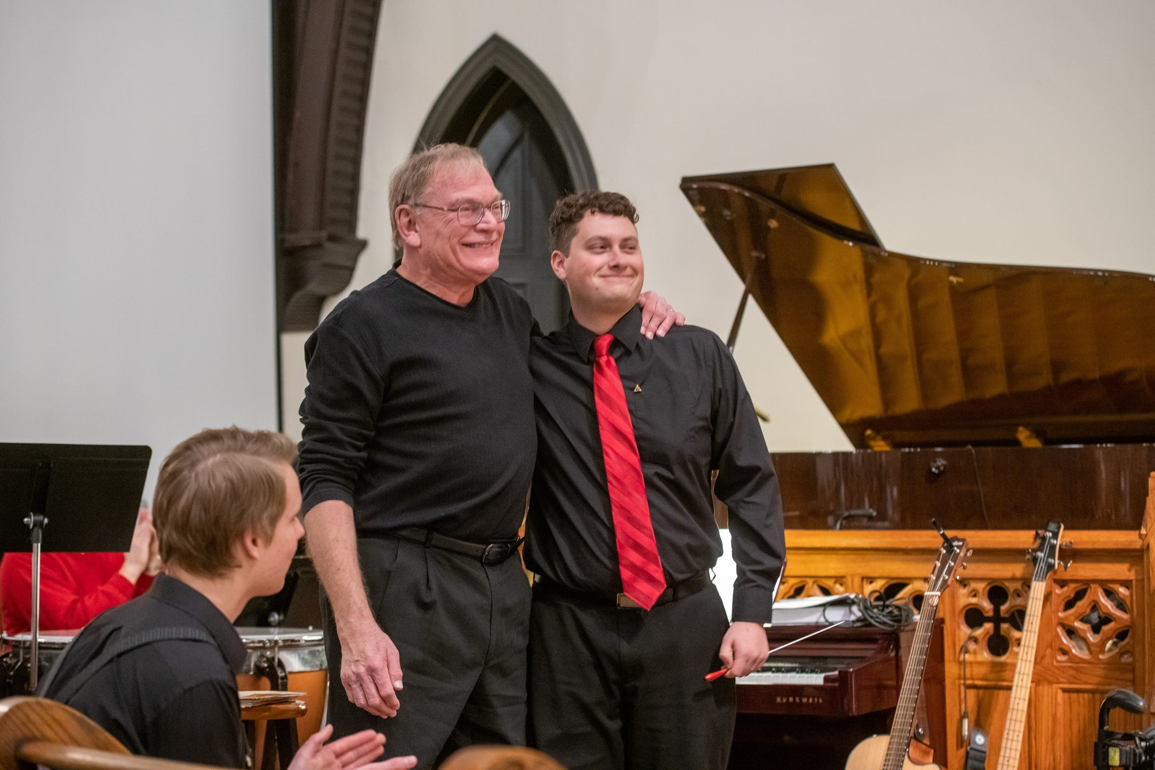 "Alan Chamness, left,  and Andrew Burns, right, are recognized after conducting the adult choir's Christmas cantata ""The Song Heard 'Round The World"" on Sunday, Dec. 16, 2018. Burns, a music student at the University of Louisville, assisted Chamness in directing the choir and orchestra."