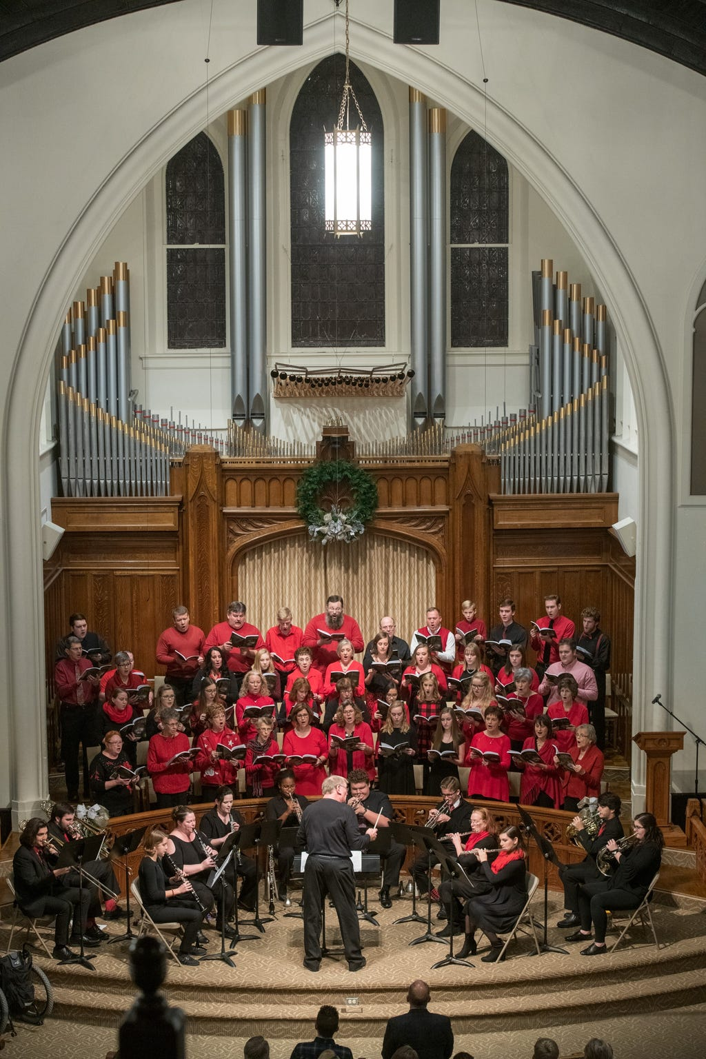 Alan Chamness conducts the choir and orchestra at Henderson's First Baptist Church during the adult choir's Christmas Cantata Sunday, Dec. 17, 2018.