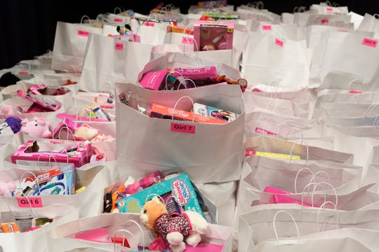 Hundreds of bags filled with toys are ready to be given to children during the Goodfellows Christmas party at South Middle School in Henderson, Sunday, Dec. 16, 2018. More than 600 children, ages 4-11, were invited to watch magic and puppet shows, get their portrait taken with Santa Claus and take home a large bag full of toys and clothing for free.