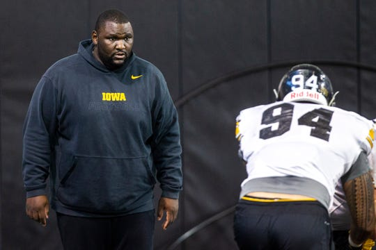 Iowa assistant defensive line coach Kelvin Bell calls out to Iowa defensive end A.J. Epenesa (94) during a NCAA football practice on Monday, Dec. 17, 2018, at the Hansen Football Performance Center in Iowa City.