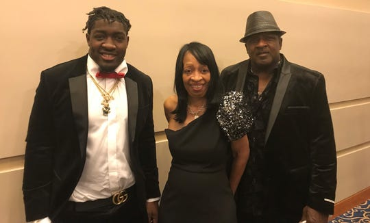 (l-r) Notre Dame linebacker Te'von Coney and his parents, Cloette Bob and Timothy Coney, at Echoes, the school's annual football awards banquet