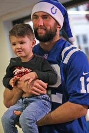 Elijah Hendricks poses with Colts' Andrew Luck at Riley Hospital for Children, Dec. 17, 2018.