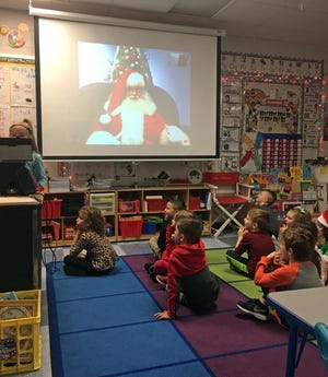 A Children's Museum Santa Claus holds a question and answer session over Skype with Emily Deaton's kindergarten class at Center Grove Elementary School.