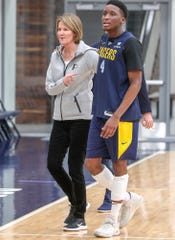After a team huddle, Indiana Pacers Assistant General Manager Kelly Krauskopf (left) walks over to give media interviews, alongside Pacers guard Victor Oladipo at the Indiana Pacers Training Facility at St. Vincent Center on Monday, Dec. 17, 2018.