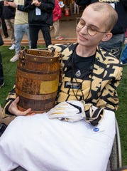 Tyler Trent holds the Ol' Oaken Bucket following a game at Memorial Stadium on Nov. 24, 2018, in Bloomington.