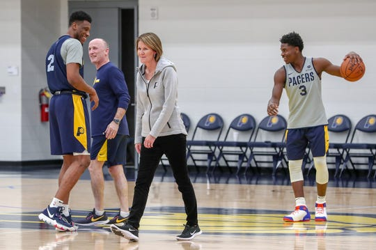 After a team huddle, Indiana Pacers Assistant General Manager Kelly Krauskopf (middle) walks over to give media interviews at the Indiana Pacers Training Facility at St. Vincent Center on Monday, Dec. 17, 2018.