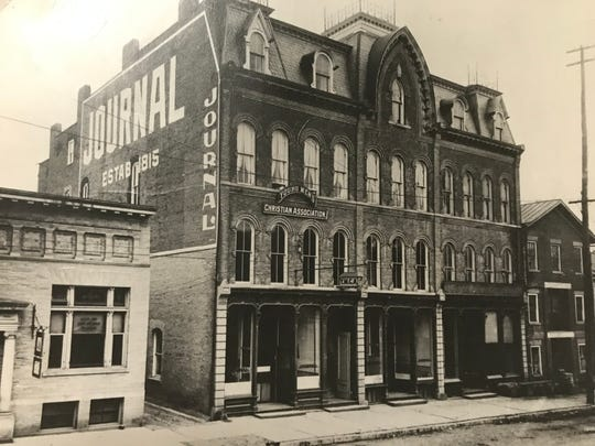For a brief period in the early 1900's, the Ithaca Journal and the YMCA shared a building.