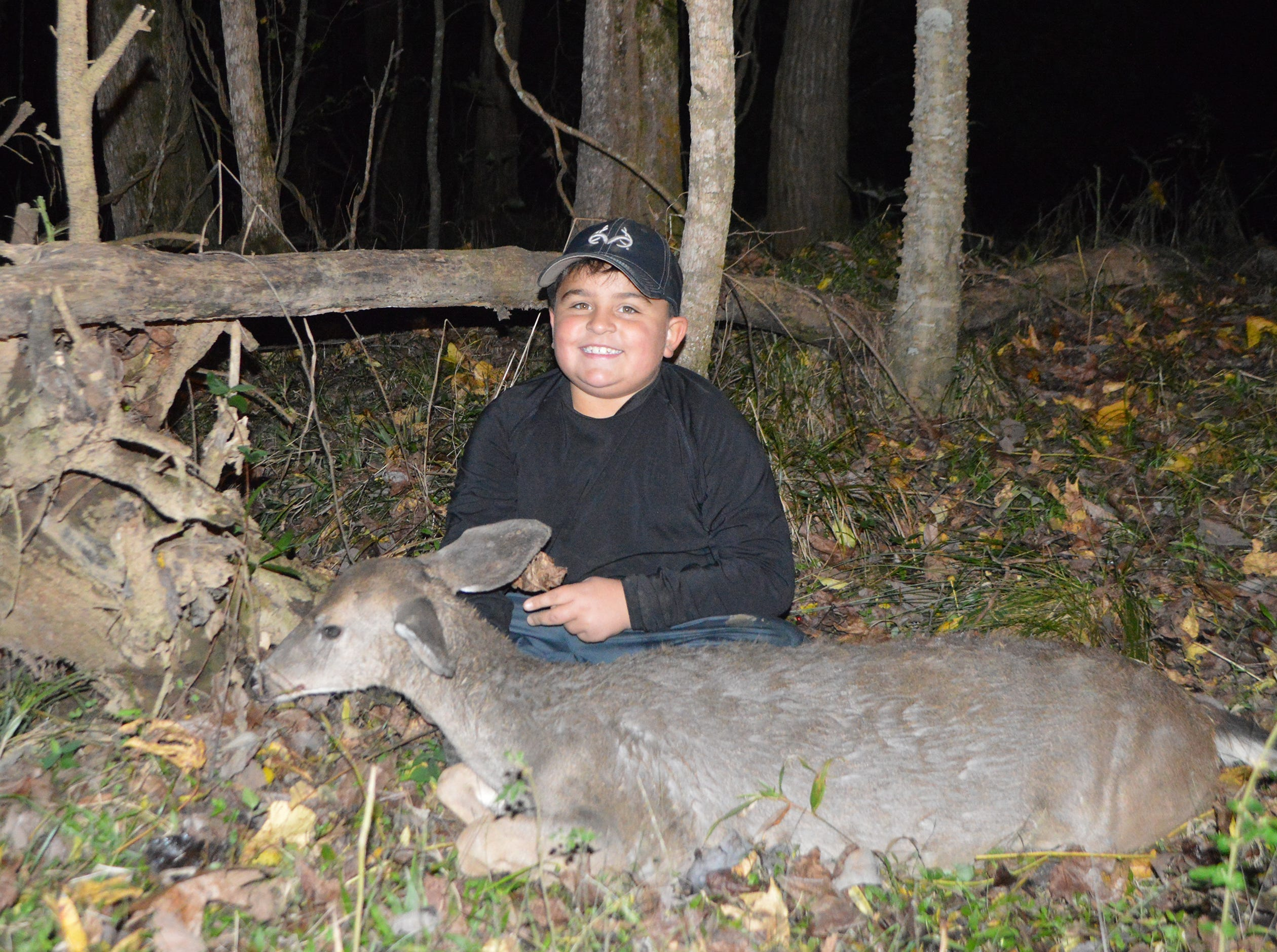 Corbin Farrell, 8, of Waveland, killed his first deer Saturday afternoon on November 10 while hunting public land with his father. He shot the deer at 150 yards while hunting from a ground blind.