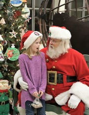 Cookies and Crafts with Santa was held at the Montessori School in Jackson on Friday, November 30, 2018 as a part of the LANA Holiday Home Tour. The event was free for children and families with many activities for the children, along with hot chocolate and cookies.  Santa listened to childrenÕs Christmas wishes and posed for photographs.