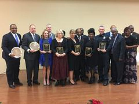Jackson Police Chief Julian Wiser stands with other recipients of the Ronald M. Cunningham Award for Community Service at the 148th Founders Celebration of the Jackson Christian Methodist Episcopal Church on Friday.