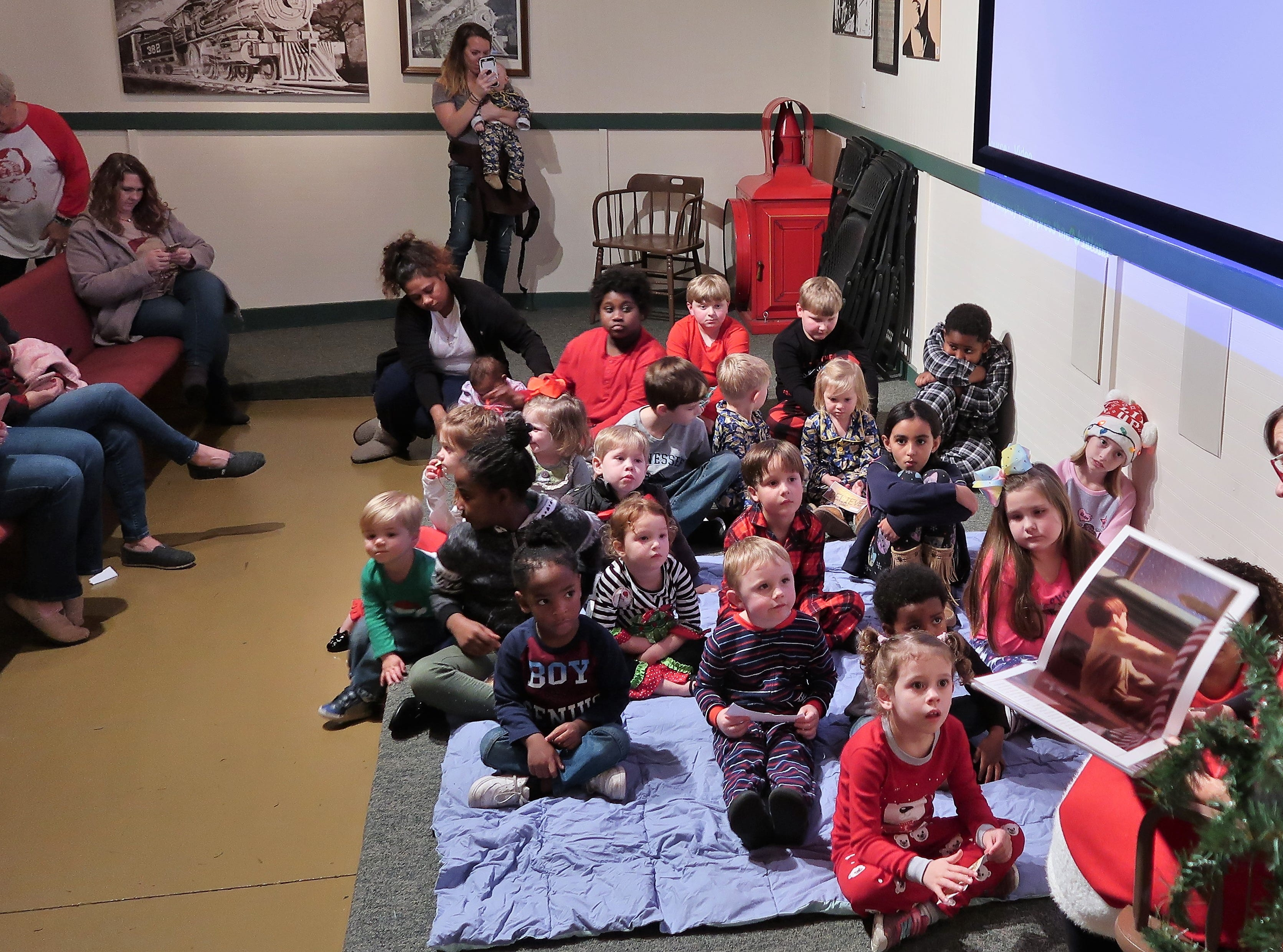 The Casey Jones Village hosted the Polar Express on Saturday, December 1, 2018 for children ages 4-10 in the Casey Jones Home and Railroad Museum.  The story of Polar Express was read to the children before they completed craft activities, toured the engine of a real train, and enjoyed cookies and hot chocolate.  Each child had the opportunity to visit and take photos with Santa.  For more information on the Polar Express events at Casey Jones Village during December, call 731-668-1222.