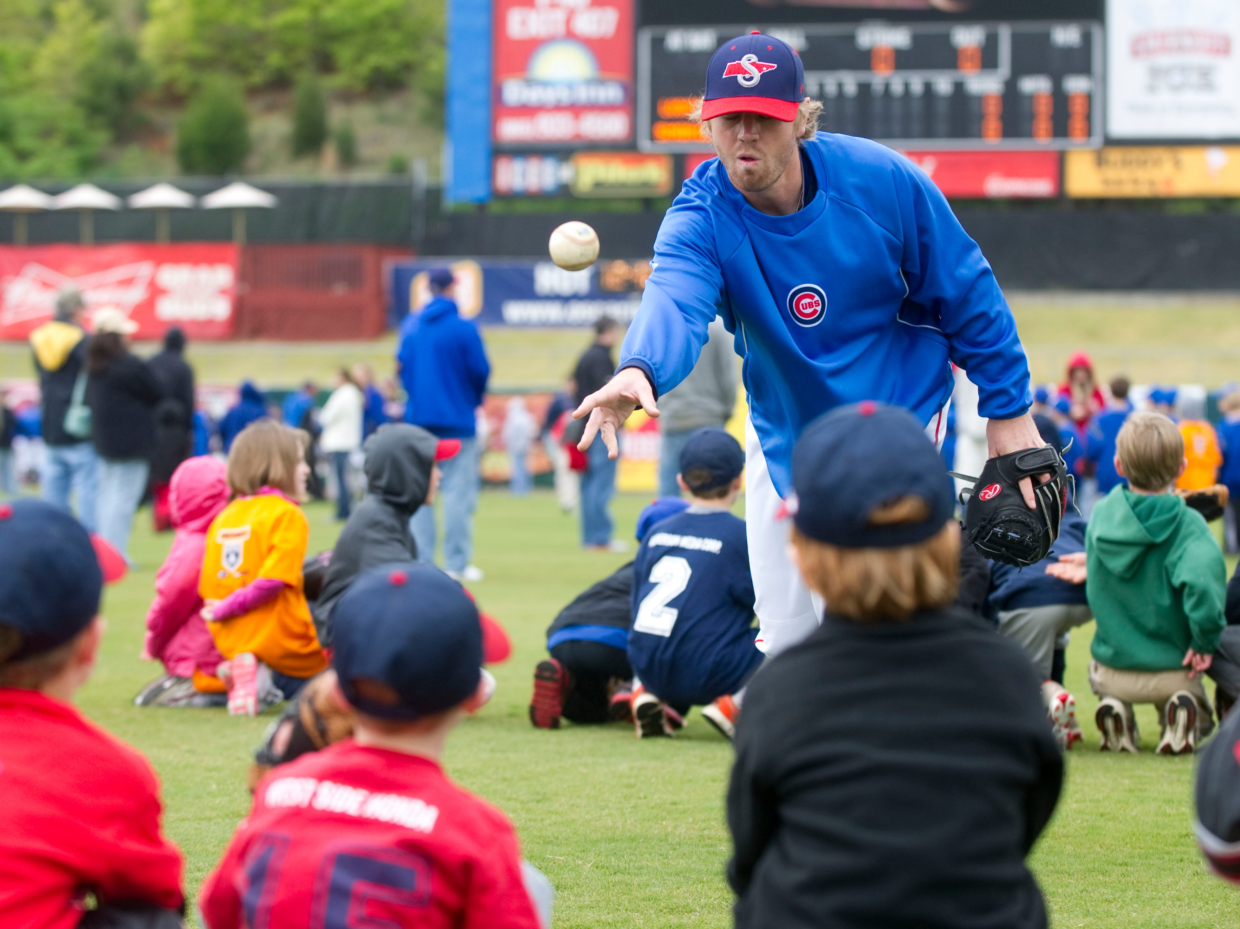 Tennessee Smokies catcher Mike Brenly works with kids during the team's annual Little League Clinic at Smokies Park on Sunday, April 22, 2012.
