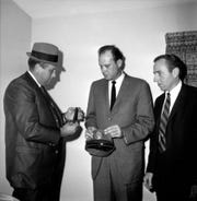 From left, Detective Bob Chadwell, Detective Carl Bunch and City Safety Director Walter Bearden examine evidence in the murder of Rose Busch on Nov. 20, 1968.