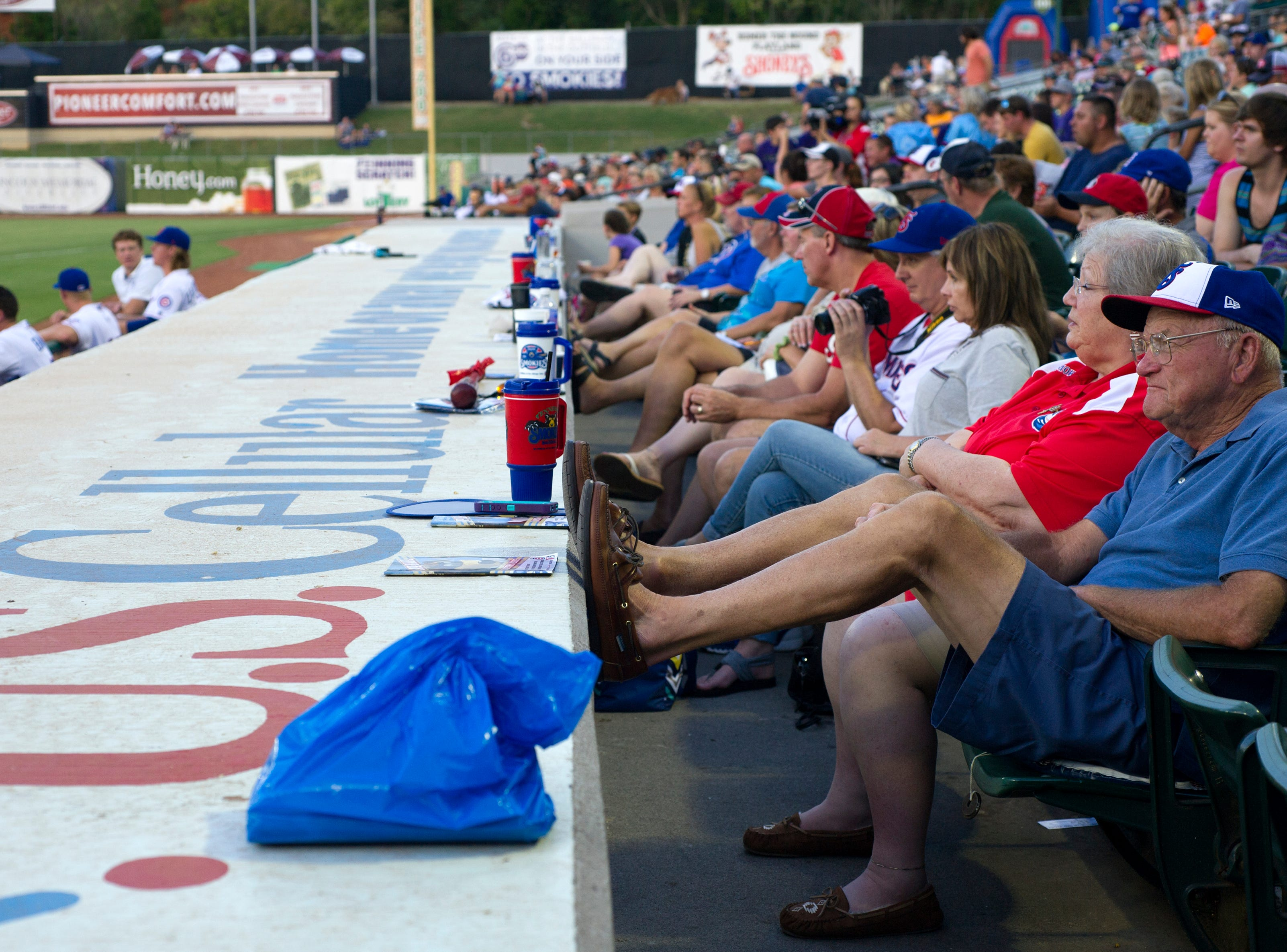 Alex Fisher of Knoxville (right) sits with his friend Edie Hummel of Knoxville during the Tennessee Smokies versus the Jacksonville Suns baseball game at Smokies Stadium in Kodak Tuesday, Sep. 1, 2015. The pair said they met at their bowling league; Hummel has had season passes for this seat for ten years.