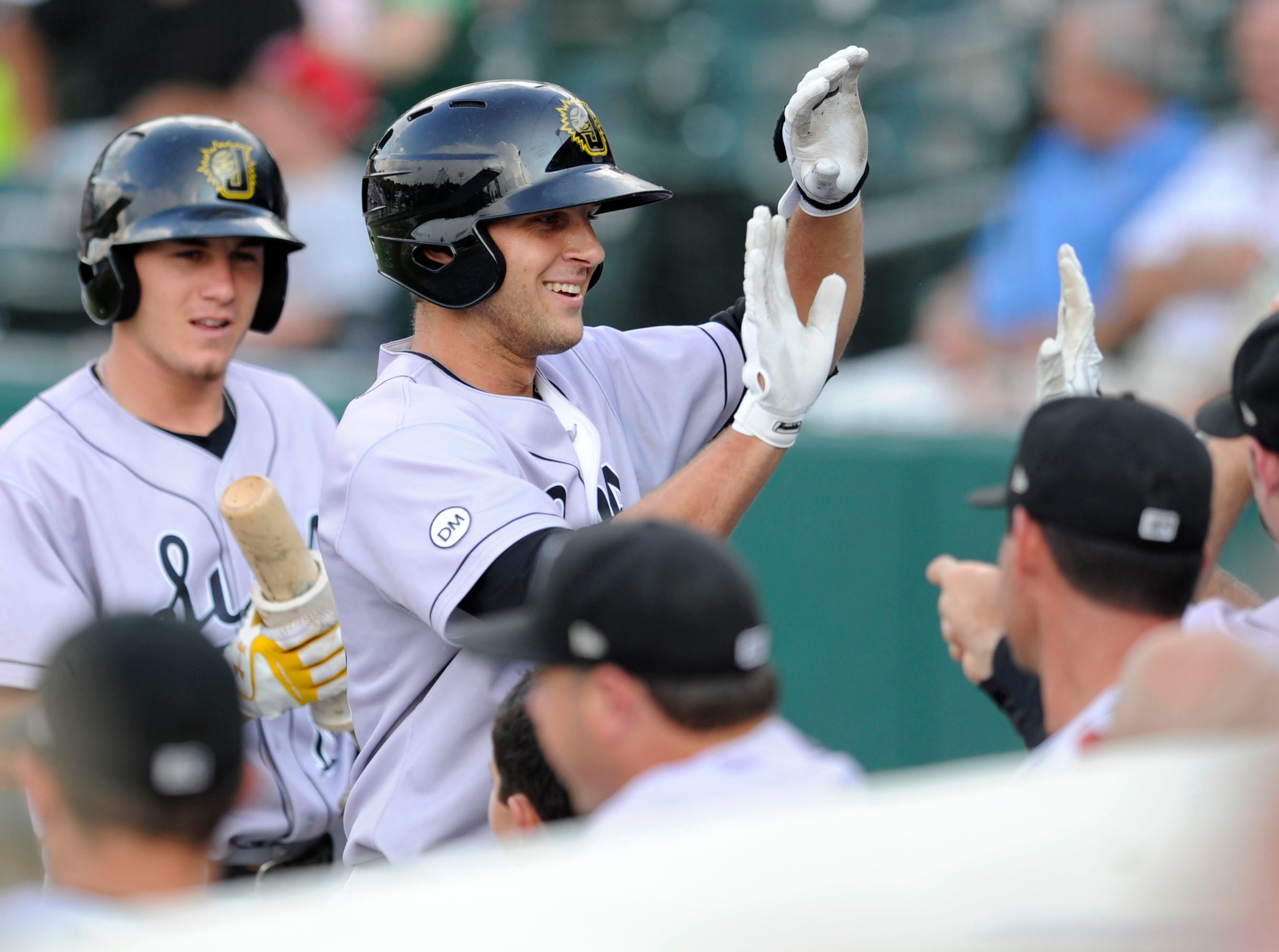 Jacksonville Suns Jake Marisnick celebrates a home run against the Tennessee Smokies at Smokies Park, Friday, July 19, 2013.