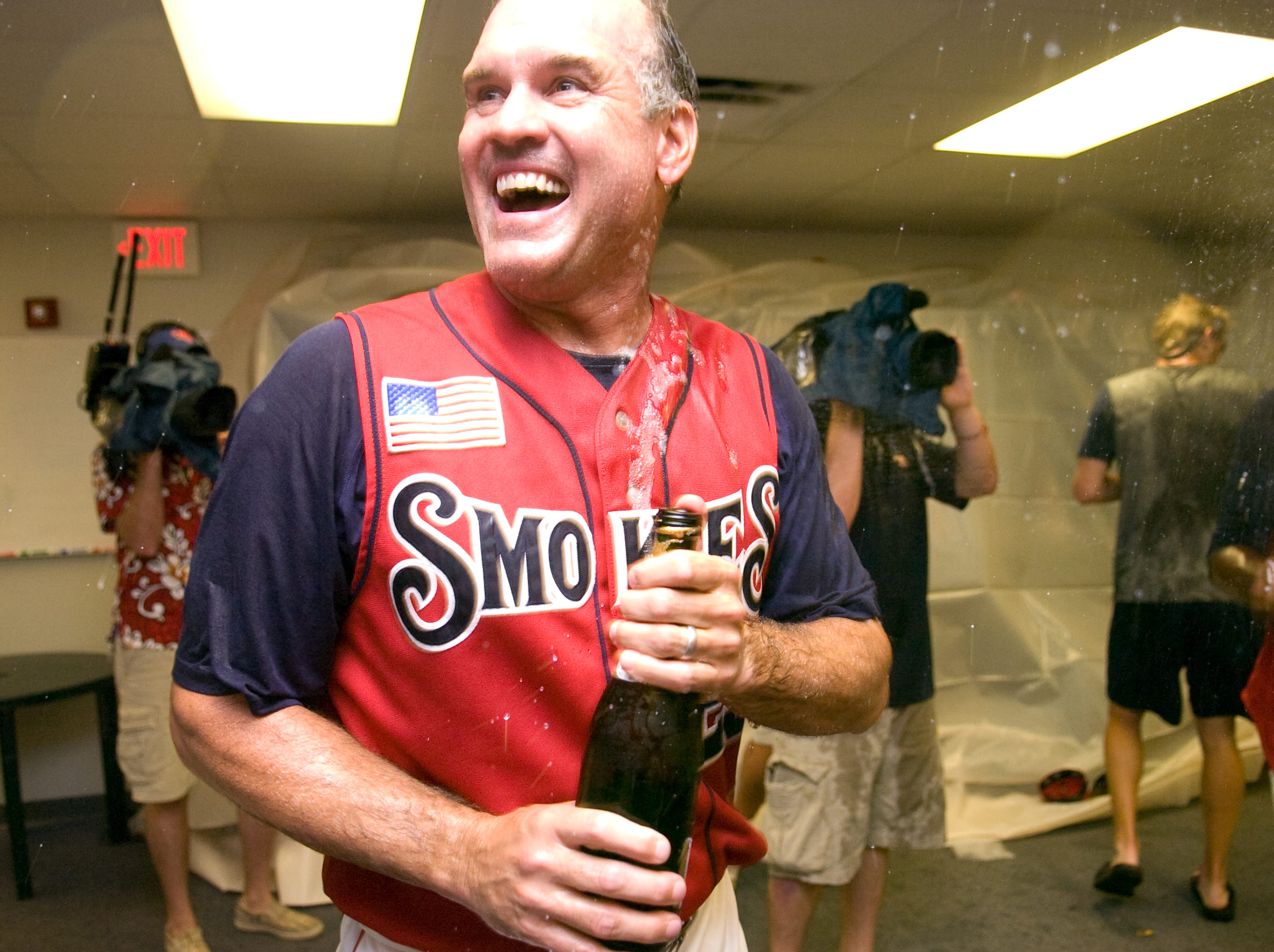 Tennessee Smokies manager Rhyne Sandberg celebrates their win over Huntsville on Sunday, Sept. 13, 2009. The Tennessee Smokies defeat the Huntsville 3-1 to win the Northern Division Southern League title.