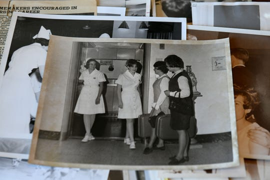 Photos laid out for alumni attending the St. Mary's School of Nursing's all classes reunion Monday, Dec. 17, 2018 at Kitchen 919. Faculty and students from 1951-1987 met for what they were calling Homecoming 2018.