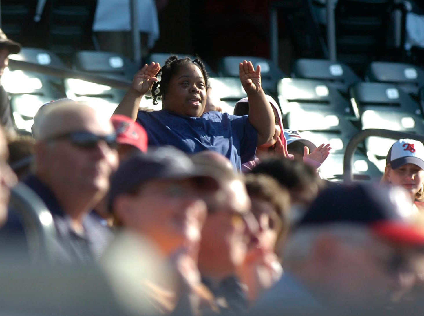 Jasmine Jackson participates in the chicken dance as her brother, Tennessee Smokies pitcher Jay Jackson, pitches against Huntsville on May 29th, 2009.