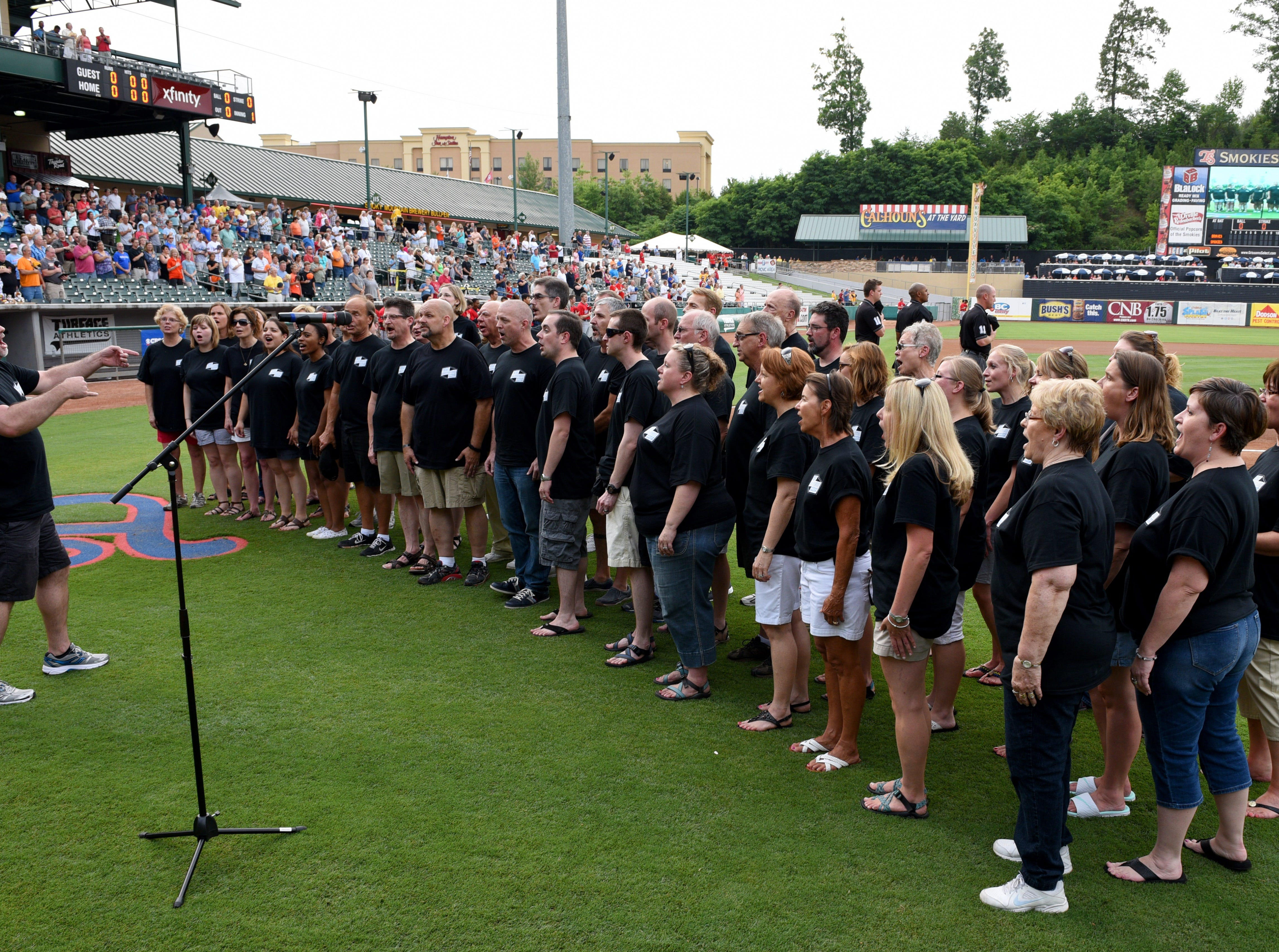The West Park Baptist Church choir sang the national anthem at the start of the Tennessee Smokies baseball game against the Mississippi Braves televised by CBS Sports Network Thursday, Jun. 18, 2015. Helen Turner, co-founder of the Love Kitchen throwing out the first pitch and money raised at the game goes to the Love Kitchen.