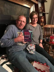 Greg Griffith shows off his Skinny Sippers book received at Charlotte Jensen's regifting party.