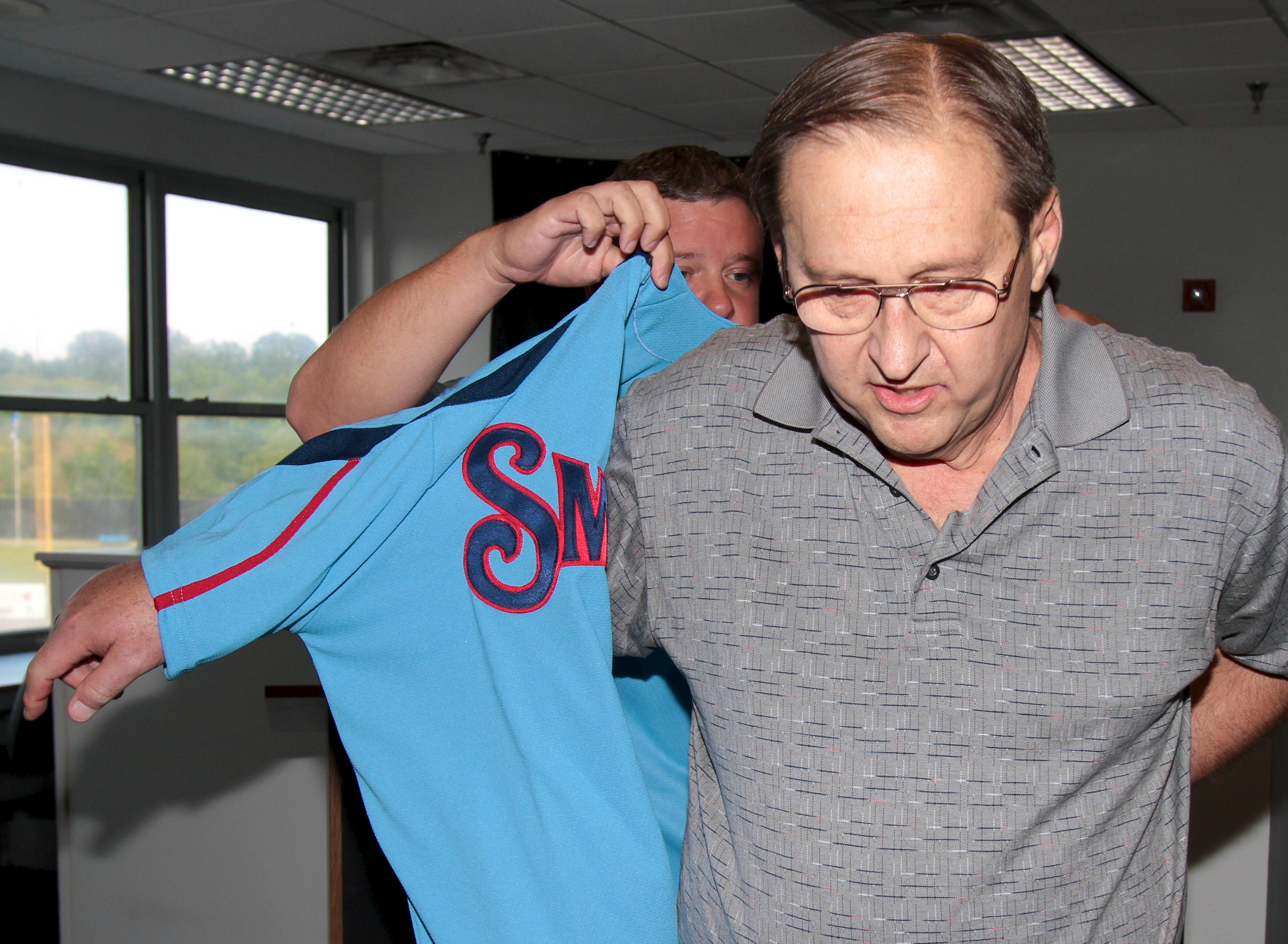 Nick Gates, front, is given a Tennessee Smokies jersey from Smokies general manager Brian Cox on Saturday, August 28, 2010 at Smokies Stadium. The press box at Smokies Stadium was named the Nick Gates Press Row.
