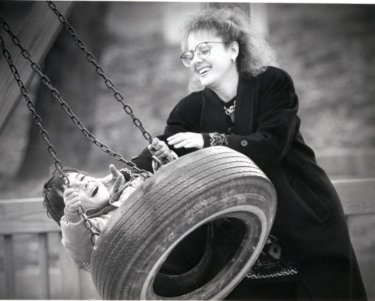 Deana Perez and her son, Jordan, take advantage of an unseasonably warm day to play in Fort Kid, January, 1993.