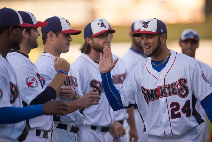 Tennessee Smokie outfielder Rubi Silva gets the glad hand from teammates during player introductions before the home opener Wednesday, April 9, 2014, at Smokies Park.