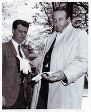 Detective Bob Chadwell holds the bloodstained gloves worn by the killer of Rose Busch on Nov. 19, 1968. At left is TBI Agent Robert Fortner.