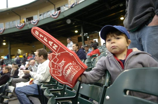 """Two year-old Nathan Whitehead of Louisville waits for the start of the home opening game for the Tennessee Smokies baseball team at Smokies Park on Wednesday. Nathan's mother Lauren Whitehead says """" Money's tight, but you still have to enjoy yourself ."""""""