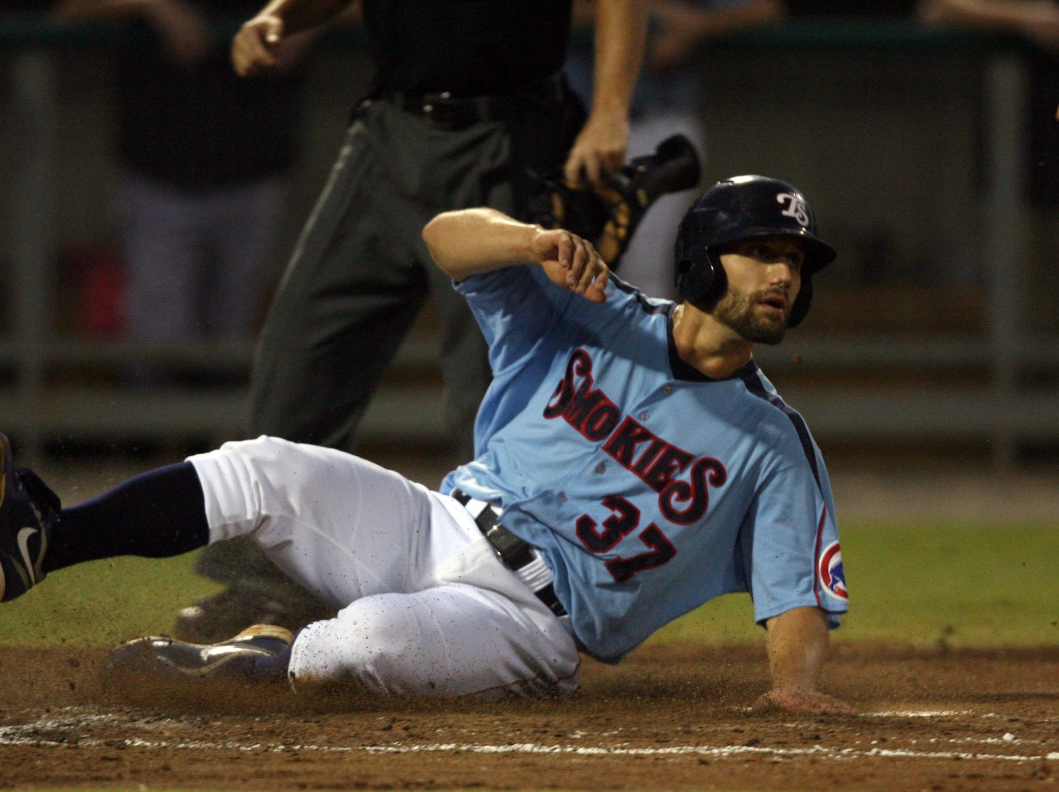 Tennessee Smokies Russ Canzler slides into home for a run during the game against the Jacksonville Suns during game 2 of the Southern League championship series at Smokies Park Wednesday, Sept. 15, 2010.