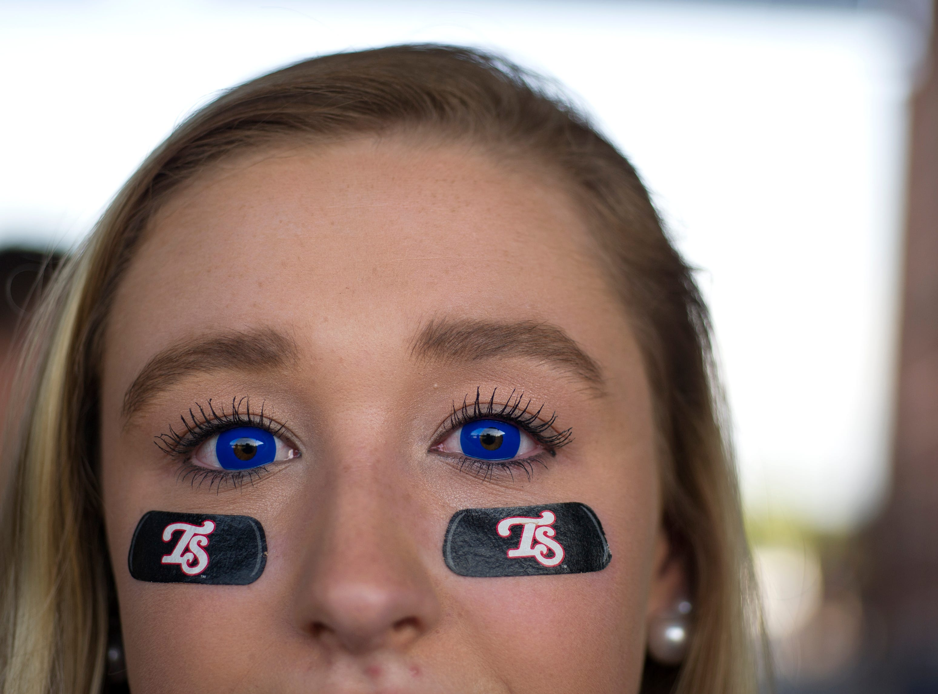 Chelsea Stokely of Jefferson City wears blue contact lenses to show her team pride during the Tennessee Smokies versus the Jacksonville Suns baseball game at Smokies Stadium in Kodak Tuesday, Sep. 1, 2015. The team's final home game was fan appreciation themed.