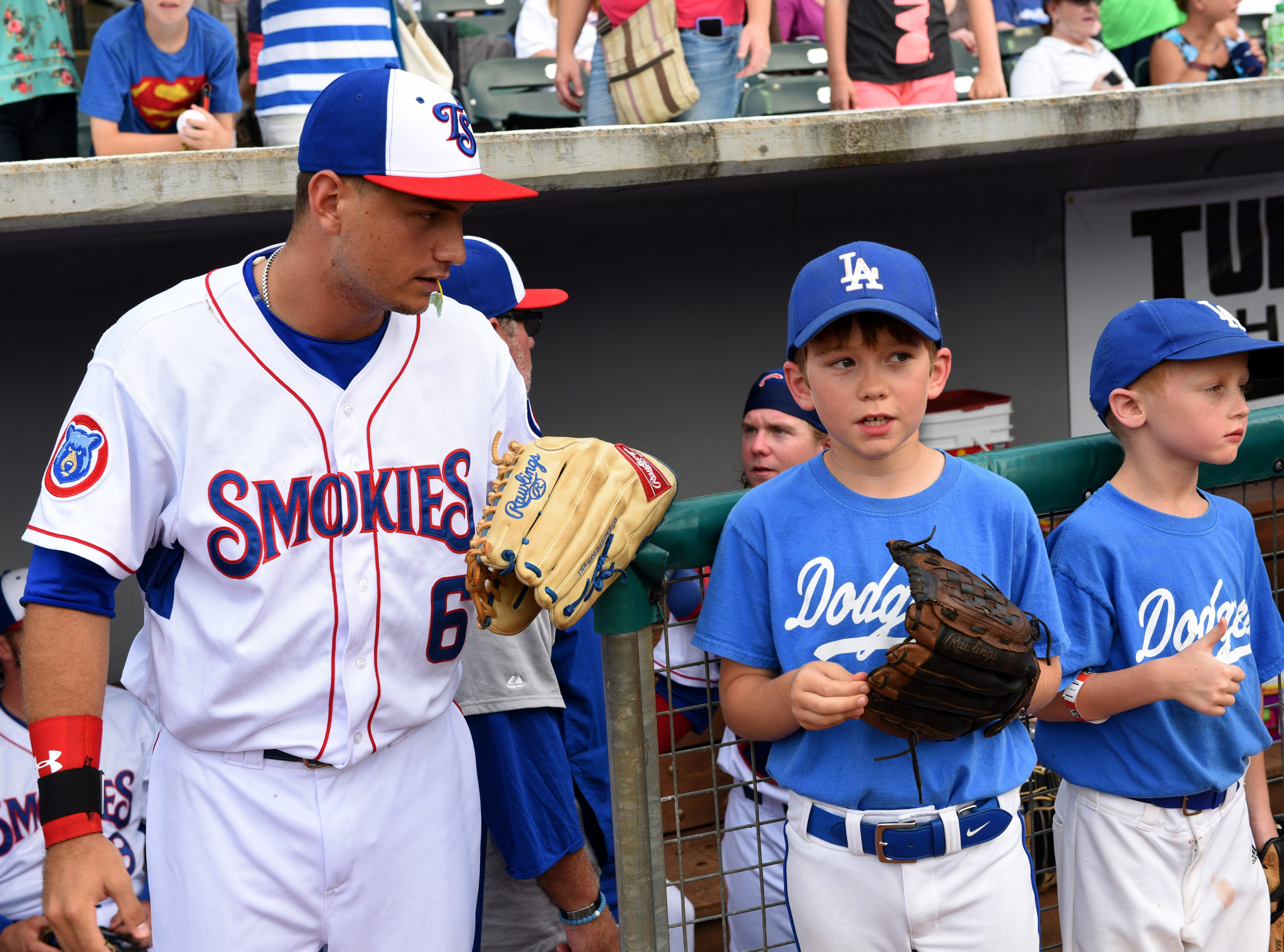 Tennessee Smokies Albert Almora Jr. talks to one of game against the Mississippi Braves televised by CBS Sports Network Thursday, Jun. 18, 2015. Helen Turner, co-founder of the Love Kitchen throwing out the first pitch and money raised at the game goes to the Love Kitchen.