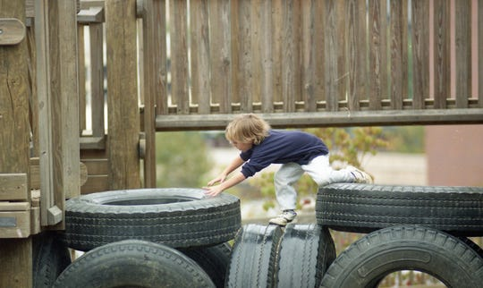 Wills Baker plays on some tires at Fort Kid Park, October, 1993.