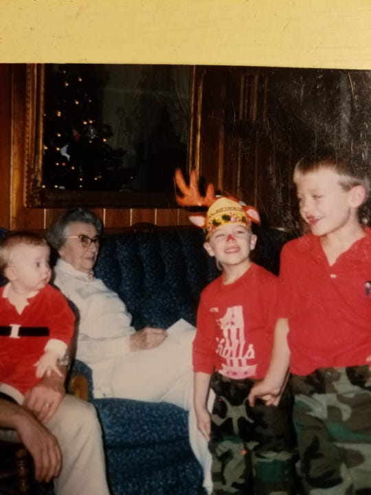 """Chad Turner, far right, sings """"All I Want For Christmas is My Two Front Teeth"""" while his brother, Jack, as Rudolph the reindeer, smiles. In background is their great-grandmother, Eula """"Minnie"""" Johnson watches in the background. Johnson created a family tradition in which her grandchildren and then her great-grandchildren would perform before opening their Christmas Eve gifts. It's a tradition the family continues today."""