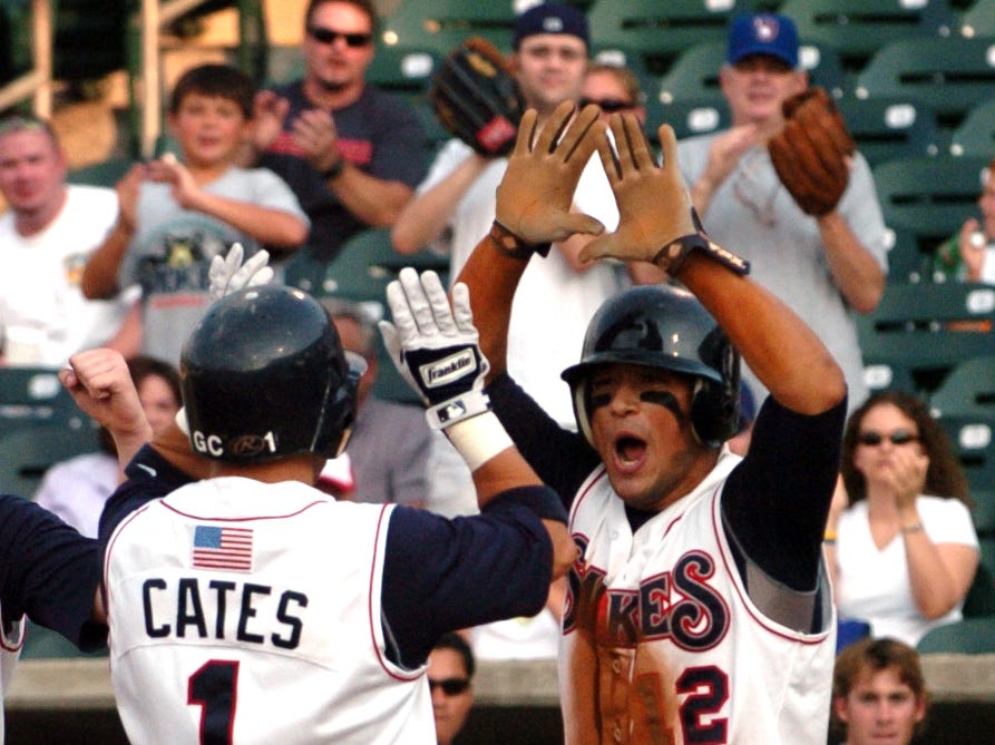 Second baseman Gary Cates (1) is meet at home after hitting a two-run homer in the sixth inning against the Huntsville Stars Saturday.  Cates is getting high-fives from Issmael Salas (12) who he knocked in. The Tennessee Smokies played the Huntsville Stars in Game 3 of the first round of the Southern League playoffs at Smokies Park in Sevierville Saturday night. The Smokies won 11-6.