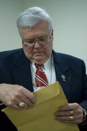 Retired TBI Agent Steve Watson looks through the Rose Busch murder case file on April 1, 2008 at the Tennessee Bureau of Investigation Knoxville Field Office.