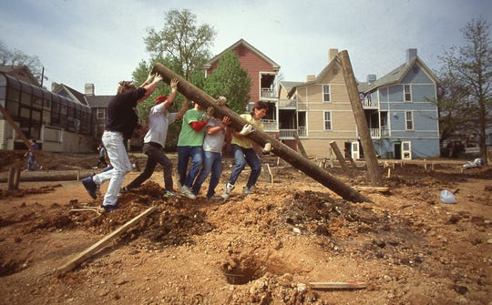 Volunteers work together to build a large playground for the children of Knoxville. Fort Kid, April, 1991.